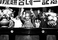 The Hon. S.Y. Lee, Vice President of South Korea, leads cheers at the close of the UN Day ceremony at Seoul.  October 24, 1950.  Sgt. Ray Turnbull.  (Army)<br /> NARA FILE #:  111-SC-35191<br /> WAR & CONFLICT BOOK #:  1379