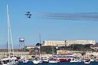 The Blue Angels F/A-18 Hornets in diamond formation pass behind Alcatraz Island during San Francisco Fleet Week 2018