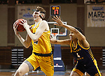 SIOUX FALLS, SD - MARCH 7: Grant Nelson #4 of the North Dakota State Bison drives past Jacob Johnson #4 of the UMKC Kangaroos during the Summit League Basketball Tournament at the Sanford Pentagon in Sioux Falls, SD. (Photo by Richard Carlson/Inertia)