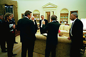On Wednesday evening, March 19, 2003, United States President George W. Bush meets with his national security and communications advisors after authorizing military operations. Present, from left, are Steve Hadley, Deputy National Security Advisor; Karen Hughes, special advisor to the President; Chairman of the Joint Chiefs of Staff Richard B. Myers; Dan Bartlett, Communications Director; US Vice President Dick Cheney, US Secretary of Defense Donald Rumsfeld, National Security Advisor Condoleezza Rice, and US Secretary of State Colin Powell.<br /> Mandatory Credit: Eric Draper / White House via CNP
