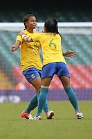 RENATA COSTA of Brazil (L) celebrates scoring the second goal for her team - Brazil Women vs Cameroon Women - Womens Olympic Football Tournament London 2012 Group E at the Millenium Stadium, Cardiff, Wales - 25/07/12 - MANDATORY CREDIT: Gavin Ellis/SHEKICKS/TGSPHOTO - Self billing applies where appropriate - 0845 094 6026 - contact@tgsphoto.co.uk - NO UNPAID USE.