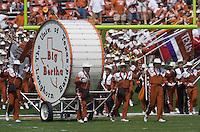 """23 September 2006: Members of the Texas Longhorn band lead """"Big Bertha"""" onto the field during the pre-game show before the Longhorns game against the Iowa State Cyclones at Darrell K Royal Memorial Stadium in Austin, TX."""