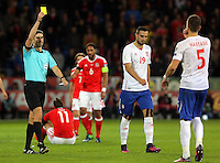 Matija Nastasic of Serbia (R) sees a yellow card by match referee Alberto Mallenco during the 2018 FIFA World Cup Qualifier between Wales and Serbia at the Cardiff City Stadium, Wales, UK. Saturday 12 November 2016