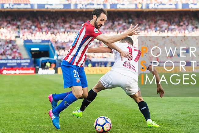 Juan Francisco Torres Belen, Juanfran (l), of Atletico de Madrid battles for the ball with Pablo Sarabia Garcia of Sevilla FC during their La Liga match between Atletico de Madrid and Sevilla FC at the Estadio Vicente Calderon on 19 March 2017 in Madrid, Spain. Photo by Diego Gonzalez Souto / Power Sport Images