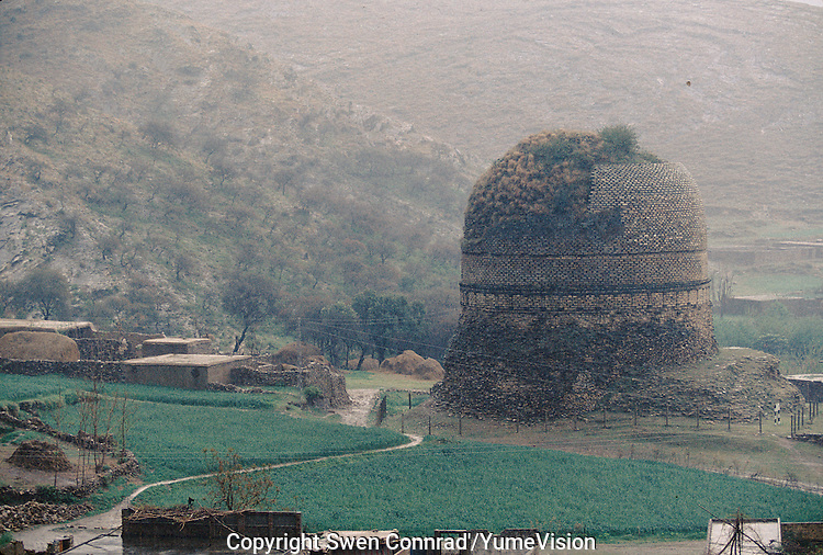 A Buddhist Stupa in the Swat valley in Pakistan. .Taxila, the main centre of Gandhara, is over 3,000 years old. Taxila had attracted Alexander the great from Macedonia in 326 BC, with whom the influence of Greek culture came to this part of the world. Taxila later came under the Mauryan dynasty and reached a remarkable matured level of development under the great Ashoka. During the year 2 BC, Buddhism was adopted as the state religion, which flourished and prevailed for over 1,000 years, until the year 10 AD. During this time Taxila, Swat and Charsadda (old Pushkalavati) became three important centers for culture, trade and learning. Hundreds of monasteries and stupas were built together with Greek and Kushan towns such as Sirkap and Sirsukh, both in Taxila.