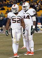 Miami linebackers Denzel Perryman (52) and Thurston Armbrister (34). The Miami Hurricanes defeated the Pitt Panthers 41-31 at Heinz Field, Pittsburgh, Pennsylvania on November 29, 2013.