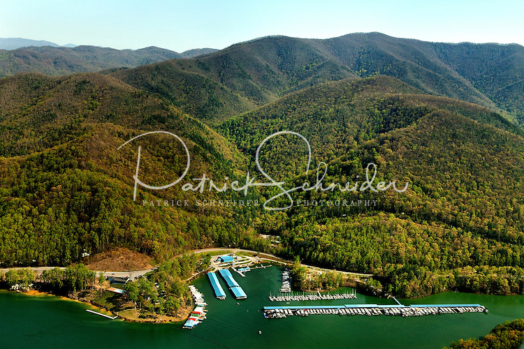 Aerial photography of and around Watauga Lake, Tenn., taken April 2011. Surrounded by the Cherokee National Forest, the vast majority of Watauga Lake's shoreline and surrounding mountains is undeveloped and pristine. Even during busy holiday weekends (photo taken on Easter weekend 2011) the large lake is rarely busy with boaters. Photo shows Lakeshore Marina.