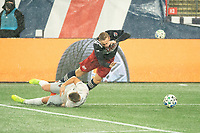 FOXBOROUGH, MA - NOVEMBER 1: Russell Canouse #4 of DC United and Adam Buksa #9 of New England Revolution collide in the penalty box during a game between D.C. United and New England Revolution at Gillette Stadium on November 1, 2020 in Foxborough, Massachusetts.