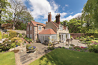 BNPS.co.uk (01202) 558833. <br /> Pic: SandersonYoung/BNPS<br /> <br /> Outside.<br /> <br /> A quirky 'show home' for a brickwork owner where Lewis Carroll is believed to have stayed while writing some of his Alice in Wonderland books is on the market for just under £1m.<br /> <br /> Red Cottage is a striking Grade II listed property in Whitburn, Tyne and Wear, where Charles Dodgson, otherwise known as Lewis Carroll, regularly visited family.<br /> <br /> The unusual 179-year-old home was built to show off as many design features as possible, and has a walled garden and even an air raid shelter.