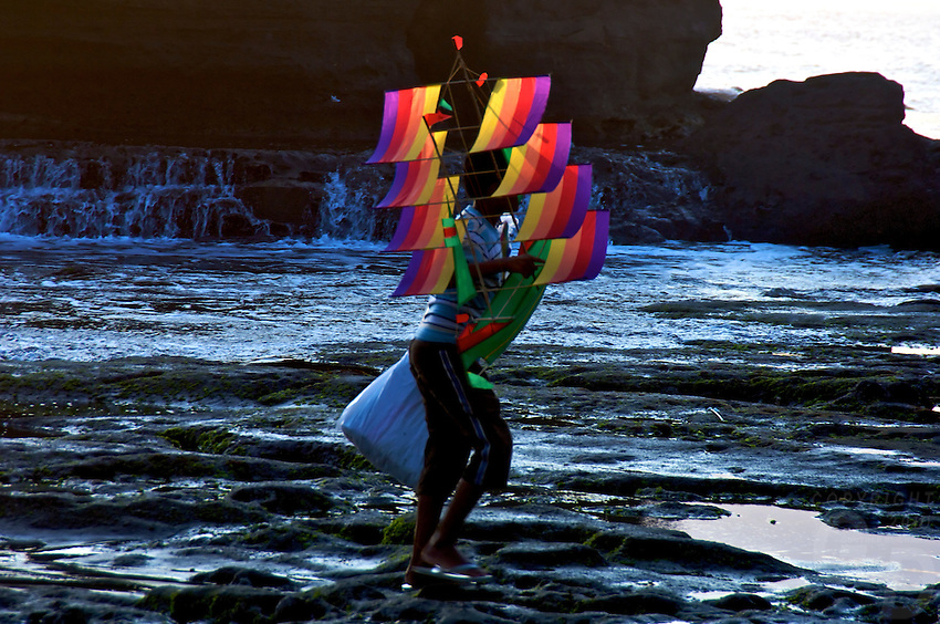 Boy selling kites to Tourists at Tanah Lot Beach