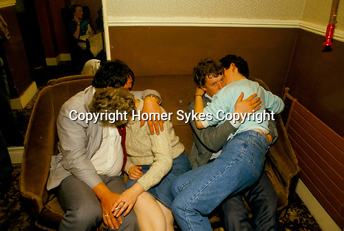 Lisdoonvarna County Clare Eire. 1990s. Spa Well Dance Hall the month long matchmaking annual festival. Couple kissing hugging  thinking about sex