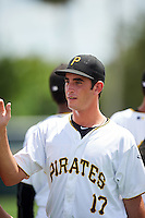GCL Pirates pitcher Claudio Scotti (17) high fives teammates after a game against the GCL Yankees East on August 15, 2016 at the Pirate City in Bradenton, Florida.  GCL Pirates defeated GCL Yankees East 5-2.  (Mike Janes/Four Seam Images)