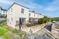 BNPS.co.uk (01202 558833)<br /> Pic:  LuscombeMaye/BNPS<br /> <br /> A former fisherman's cottage with incredible waterfront views is on the market for £900,000.<br /> <br /> Tuckers is the end property in a row of iconic cottages in Salcombe, Devon, that looks out over a pontoon where the town's lifeboat launches from.<br /> <br /> The eight properties were built in the early 19th century along the sea wall but are now mostly holiday cottages, thanks to their magical location.<br /> <br /> The small cottage has just 557 sq ft of living space with an open plan kitchen/dining/reception room downstairs and two bedrooms and two shower rooms upstairs.