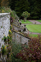 A row of stone busts ornament the butresses that support the terrace leading down to the extensive gardens