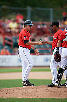 Erie SeaWolves manager Lance Parrish (13) takes the ball from relief pitcher Gerson Moreno to make a pitching change during a game against the Akron RubberDucks on August 27, 2017 at UPMC Park in Erie, Pennsylvania.  Akron defeated Erie 6-4.  (Mike Janes/Four Seam Images)