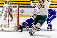 16 February 2019: Holy Cross Crusader Goaltender Julia Pelletier, a Sophomore from Pelham, NH, gives up a second period goal to University of Vermont Catamount Forward Val Caldwell, a Sophomore from Glenview, IL, at Gutterson Fieldhouse in Burlington, Vermont. The Lady Cats defeated the Crusaders 4-1 to sweep their 2-game weekend series. Mandatory Credit: Ed Wolfstein Photo *** RAW (NEF) Image File Available ***