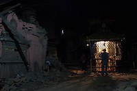 A man prays in front of a destroyed temple in Bhaktapur, near Kathmandu, Nepal. May 04, 2015