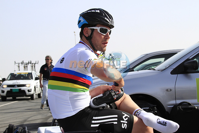 Team Sky Procycling World Champion Mark Cavendish (GBR) tightens his cleats before the 2nd Stage of the 2012 Tour of Qatar an 11.3km team time trial at Lusail Circuit, Doha, Qatar. 6th February 2012.<br /> (Photo Eoin Clarke/Newsfile)