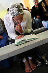 A ROMa woman reading the Bible during a Sunday service at the Pentecostal church in Barbulesti, Romania. 15 years ago, the population of Barbulesti, a village situated in the south of Romania and inhabited mostly by ROMa people, started to convert to the Pentecostal Church. Believers say that conversion led to a decrease in crime in the area, although official statistics do not confirm it.