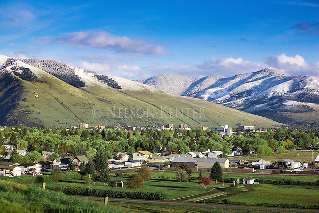 A late spring snowfall leaves a distinct snow line on the hills around Missoula, Montana