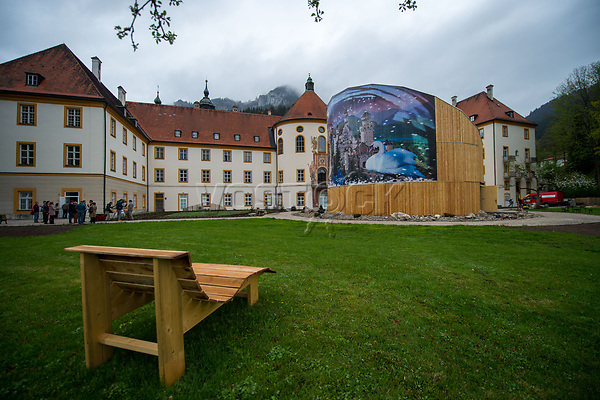 """26 April 2018, Germany, Ettal: A wooden bench near the """"Holz erleben"""" (lit. """"Experience wood"""")pavillion in the grounds of Ettal Abbey. The Bayerische Landesausstellung 2018 (lit. Bavarian State Exhibition 2018) is set to open on 02 May. Photo: Lino Mirgeler/dpa"""