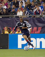 New England Revolution defender Darrius Barnes (25) dribbles. The New England Revolution defeated Houston Dynamo, 1-0, at Gillette Stadium on August 14, 2010.