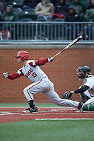 Jordan McFarland (13) of the Arkansas Razorbacks follows through on his swing against the Charlotte 49ers at Hayes Stadium on March 21, 2018 in Charlotte, North Carolina.  The 49ers defeated the Razorbacks 6-3.  (Brian Westerholt/Four Seam Images)