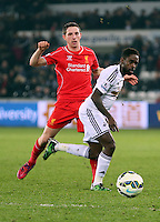 SWANSEA, WALES - MARCH 16: L-R Joe Allen of Liverpool challenges Nathan Dyer of Swansea during the Premier League match between Swansea City and Liverpool at the Liberty Stadium on March 16, 2015 in Swansea, Wales