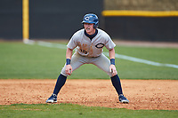 Joe Butts (10) of the Catawba Indians takes his lead off of first base against the Queens Royals during game one of a double-header at Tuckaseegee Dream Fields on March 26, 2021 in Kannapolis, North Carolina. (Brian Westerholt/Four Seam Images)