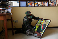 A Bolivian Navy student cleans a photograph of President Evo Morales in an office at the naval school in La Paz. Bolivia lost what is now northern Chile in a war over nitrates leaving Bolivia without access to the ocean.