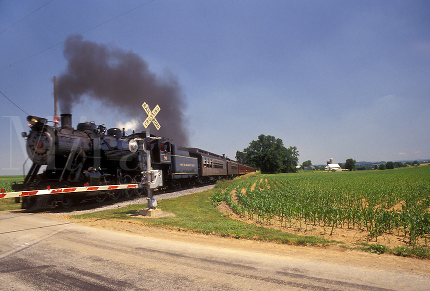 AJ4282, train, locomotive, Strasburg Rail Road Company, excursion train, Lancaster County, Amish Country, Pennsylvania, Steam locomotive pulls the passenger train through the railroad crossing in scenic Pennsylvania Dutch Country in Lancaster County in the state of Pennsylvania.
