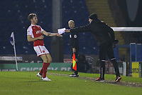 Fleetwood Town manager Uwe Rösler gives a paper instructions to his Fleetwood Town's Joe Maguire from the dug-out during the The Checkatrade Trophy match between Bury and Fleetwood Town at Gigg Lane, Bury, England on 9 January 2018. Photo by Juel Miah/PRiME Media Images.