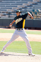 Tyson Ross #66 of the Oakland Athletics pitches in an intrasquad game during spring training workouts at Phoenix Municipal Stadium on February 24, 2011  in Phoenix, Arizona. .Photo by:  Bill Mitchell/Four Seam Images.