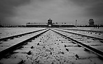 The main entrance to Auschwitz II-Birkenau concentration camp Sunday Dec 28 2014. Auschwitz concentration camp was a network of German Nazi concentration camps and extermination camps built and operated by the Third Reich in Polish areas annexed by Nazi Germany during World War II, the camp was liberated on January 27, 1945 by Soviet troops. Photo By Eyal Warshavsky
