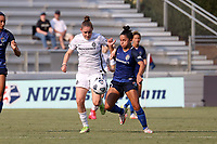 CARY, NC - SEPTEMBER 12: Olivia Moultrie #42 of the Portland Thorns FC and Debinha #10 of the North Carolina Courage challenge for the ball during a game between Portland Thorns FC and North Carolina Courage at Sahlen's Stadium at WakeMed Soccer Park on September 12, 2021 in Cary, North Carolina.