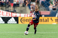 FOXBOROUGH, MA - JULY 7: Teal Bunbury #10 of New England Revolution brings the ball forward during a game between Toronto FC and New England Revolution at Gillette Stadium on July 7, 2021 in Foxborough, Massachusetts.