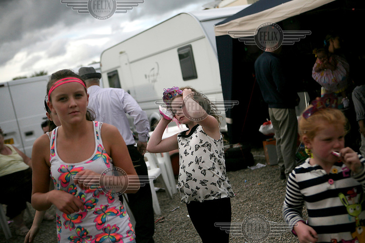 Mary Ann Sheridan and her family celebrate at their cousin Kaitlin's first birthday party on a stormy day at Dale Farm, an Irish Travellers' site on a former scrapyard in Essex.