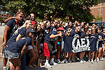 "August 20, 2011. Chapel Hill, NC.. American Eagle ""brand ambassadors"" and volunteers pose for a photo before before heading out to spread awareness of the brand by helping incoming students with their stuff and giving away coupons on move in day.. Many companies have increased their efforts to reach the youth market by employing popular college students to raise the awareness of the brand by peer to peer marketing on campus' around the country."