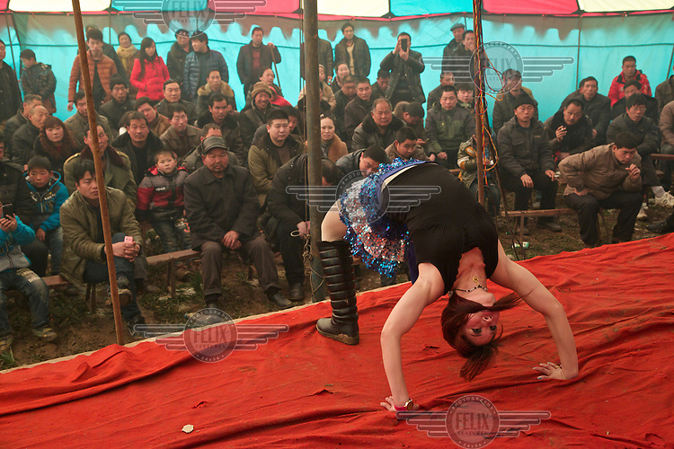 A dancer performs at the Ma Jie folk festival. <br /> <br /> For centuries farmers in Henan have gathered during Chinese New Year in the region's wheat fields to listen to bards singing and recounting old tales. <br /> <br /> Now storytellers come from all over China to attend the annual festival where large crowds gather to watch the best performers.