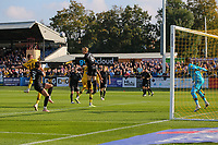 9th October 2021;  VBS Community Stadium, Sutton, London; EFL League 2 football, Sutton United versus Port Vale; Nathan Smith (6) of Port Vale heading the ball away from his goal to clear