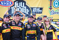 May 1, 2011; Baytown, TX, USA: NHRA funny car driver Jeff Arend (center) celebrates with his crew after winning the Spring Nationals at Royal Purple Raceway. Mandatory Credit: Mark J. Rebilas-