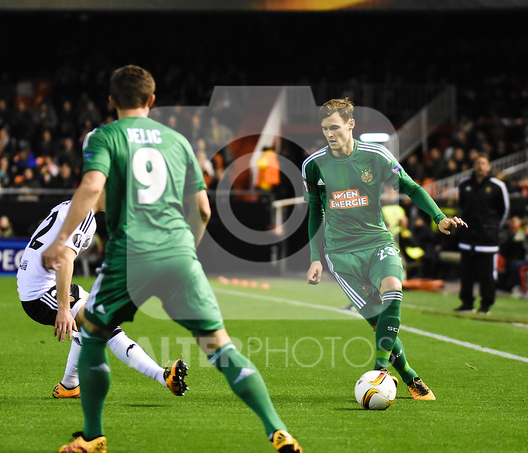 Valencia's  Joao Cancelo  and Rapid Wien's Matej Jelic and Stefan Stangl  during Uefa Europa League match. February 18, 2016. (ALTERPHOTOS/Javier Comos)