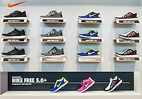 Nike Free running shoe display in a Nike store.