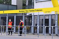 16th May 2020, Signal Iduna Park, Dortmund, Germany; Bundesliga football, Borussia Dortmund versus FC Schalke;  Stewards with mouthguards stand in front of the Signal Iduna Park in Dortmund