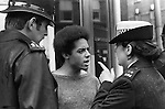 "SUS Law, allowed the police to Stop and Search any ""SUSpected person"" any where any time. Special Patrol Group policewoman gives a black youth a finger wagging. Kings Road, Chelsea, London England. 1977."