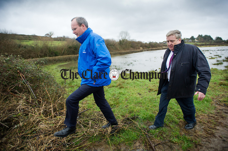 Minister for Agriculture, Food and the Marine, Simon Coveney viewing the storm damage to the river defences and lands at Lacknashannagh, Kildysart, accompanied by  Pat Breen, TD during his visit to Clare. Photograph by John Kelly.
