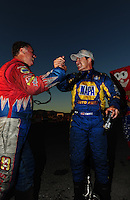 Oct. 30, 2011; Las Vegas, NV, USA: NHRA funny car driver Ron Capps (right) is congratulated by teammate Johnny Gray after winning the Big O Tires Nationals at The Strip at Las Vegas Motor Speedway. Mandatory Credit: Mark J. Rebilas-