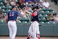 Right fielder Wil Dalton (26) of the Greenville Drive is greeted by Yusneil Padron-Artilles (16) in a game against the Aberdeen IronBirds on Sunday, July 11, 2021, at Fluor Field at the West End in Greenville, South Carolina. (Tom Priddy/Four Seam Images)