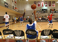 Warm-ups at RBK U camp take place before the championship game with Verdell Jones, center, watching his teammates on the court Tuesday, July 10, 2007, on the campus of Philadelphia University in Philadelphia, Pa. (The New York Times/Bradley C Bower)