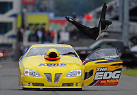 Sept. 17, 2011; Concord, NC, USA: The fire suit for NHRA pro stock driver Rodger Brogdon (not pictured) flies through the air after Brogdon threw it during qualifying for the O'Reilly Auto Parts Nationals at zMax Dragway. Mandatory Credit: Mark J. Rebilas-US PRESSWIRE